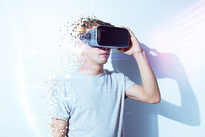 "A man ""fades away"" as he wears an AR/VR headset."