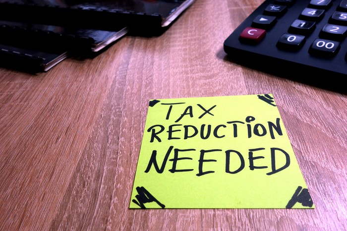 Post-it note reading tax reduction needed