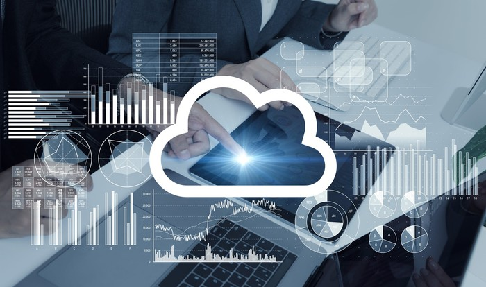 A cloud icon, two people, and a workstation.