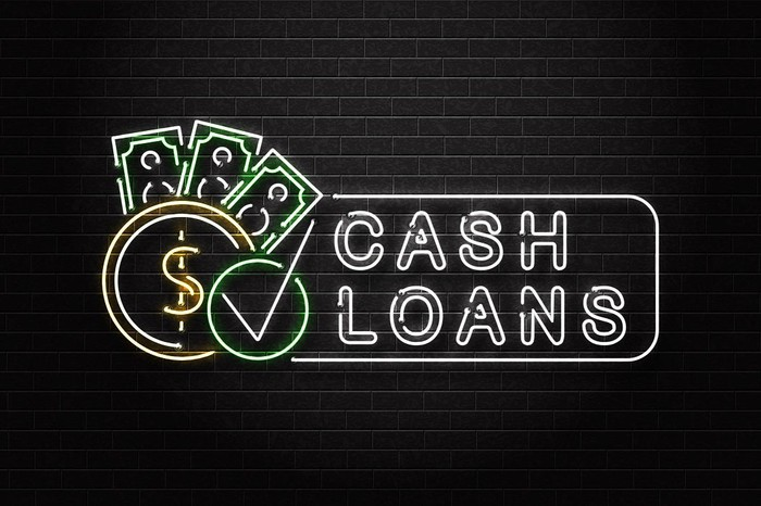 "Neon sign that reads ""Cash Loans."""