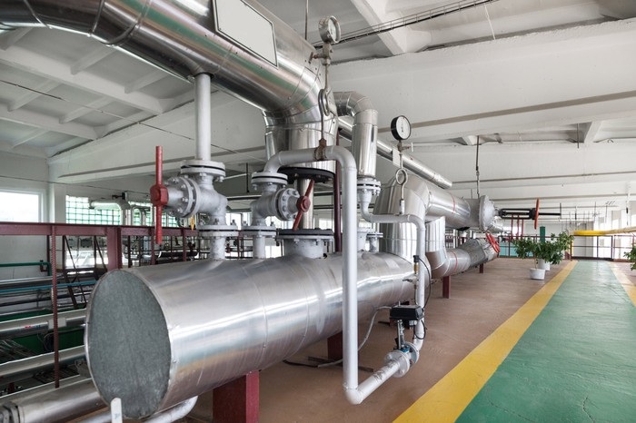 Modern boiler and steam generator spanning an entire building floor.