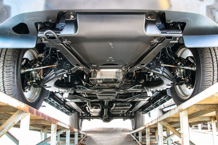 The underside of a car revealing the transmission and engine.