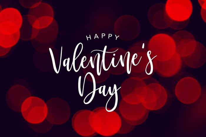 The words happy Valentine's Day in white against black background with red circles