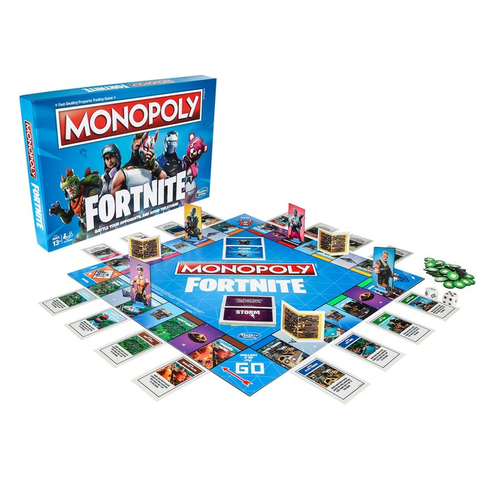 """A special edition Monopoly game based on video game """"Fortnite"""" spread out on a table."""