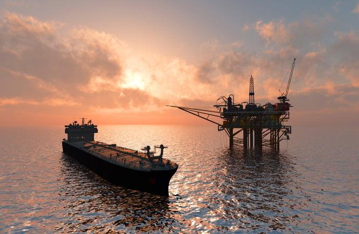 Oil tanker at offshore platform.