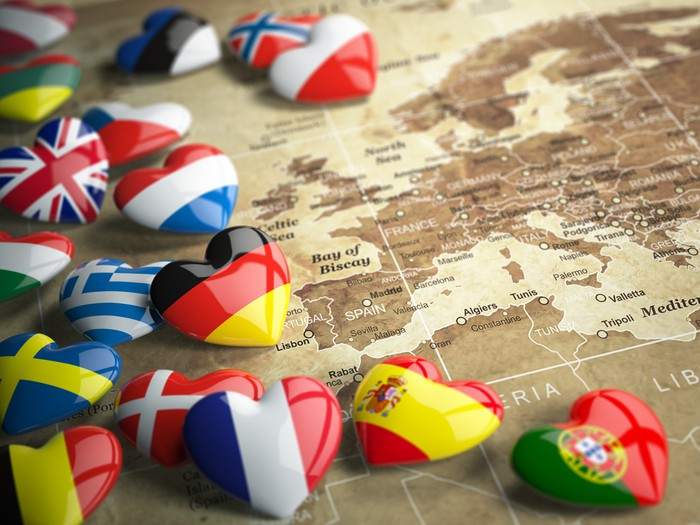 Heart-shaped flags on top of a map of Europe and Africa