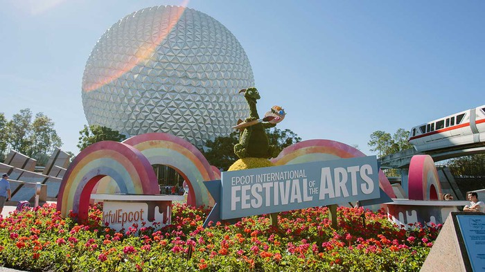 Festival of the Arts garden in front of Spaceship Earth at Disney World's EPCOT.