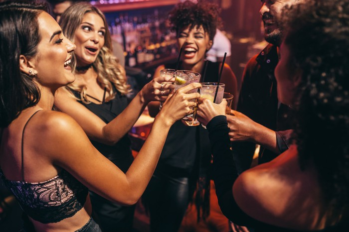 several women at a bar toasting their success