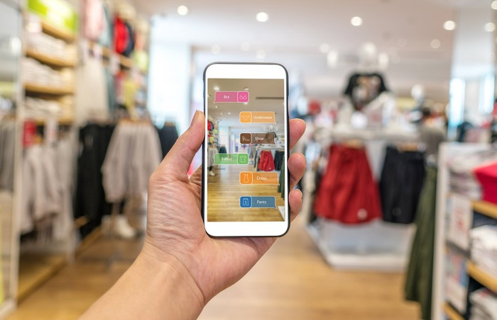 A shoppers uses an AR app in a store.