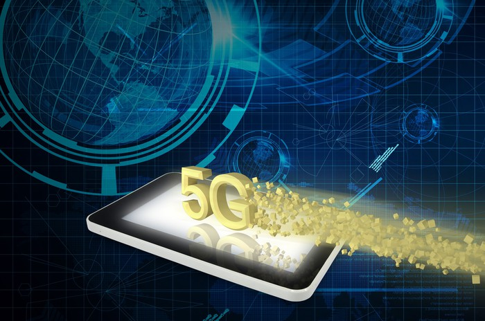 "Rendering of ""5G"" suspended over a mobile device, with a globe in the background"