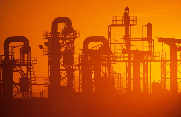 Oil refinery at sunset.