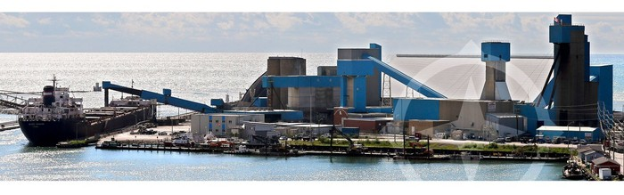 Salt manufacturing facility with plant and lakeside cargo loading terminal.