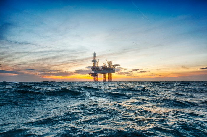 Offshore drilling rig on water.