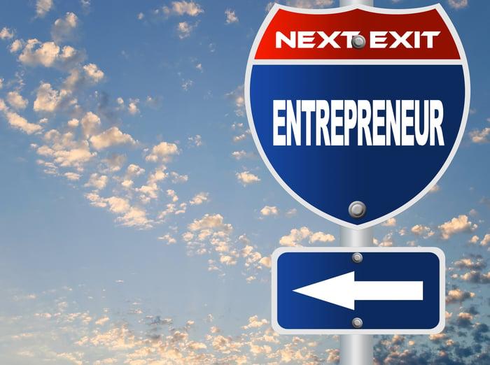 A road sign labeled next exit entrepreneur