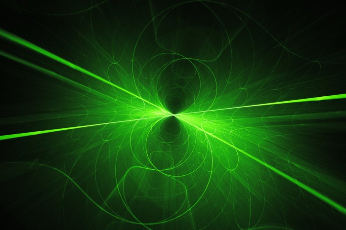 Green laser beams converge against a black background.