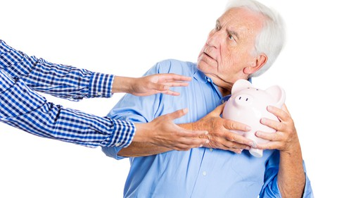old man moving piggy bank away from outstretched arms