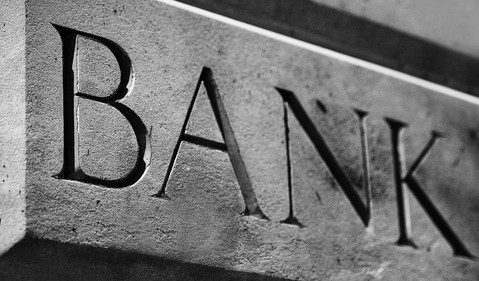 small bank sign carved into stone