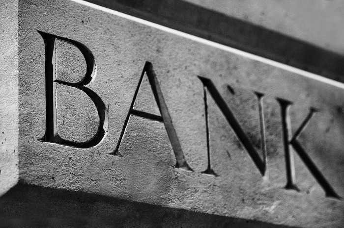 """Word """"bank"""" carved into stone."""