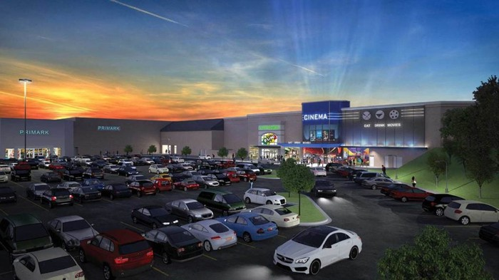 A rendering of a movie theater and parking lot attached to a mall.