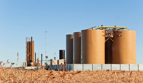 Storage tanks and treater for separating water from crude or condensate from natural gas.