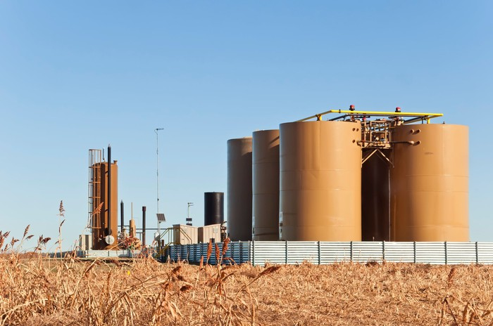 Storage tanks and a treater for separating water from crude oil and natural gas.