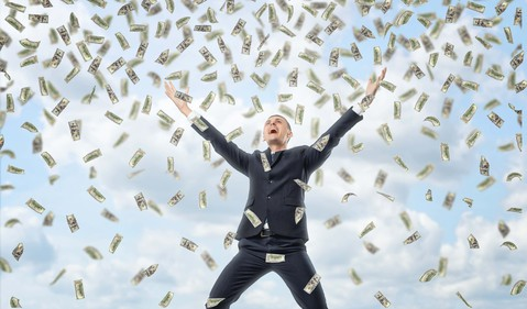money-raining-down-on-business-man-from-sky