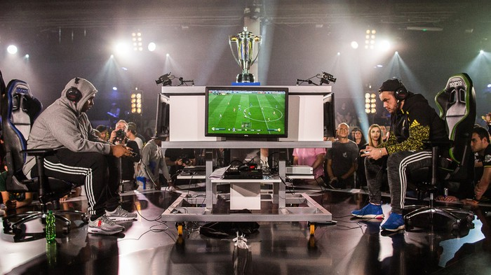 Two gamers facing off during Electronic Arts' FIFA Championship esports event