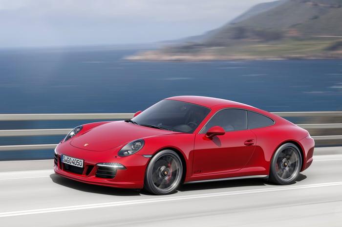 A red 2016 Porsche 911 sports car.