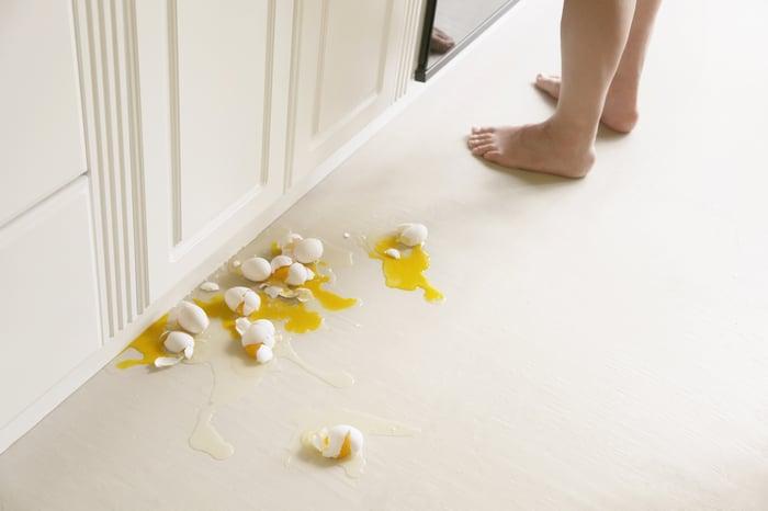 Broken eggs on floor.