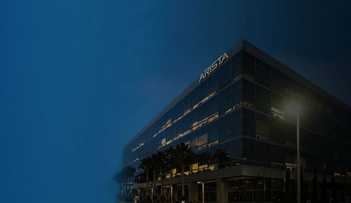 Building with Arista name on the side at dusk