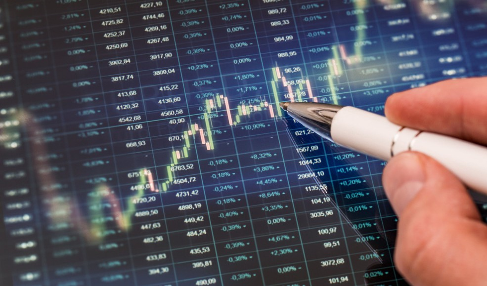18_08_21 candle stick chart with stock quotes in the background_GettyImages-842444522