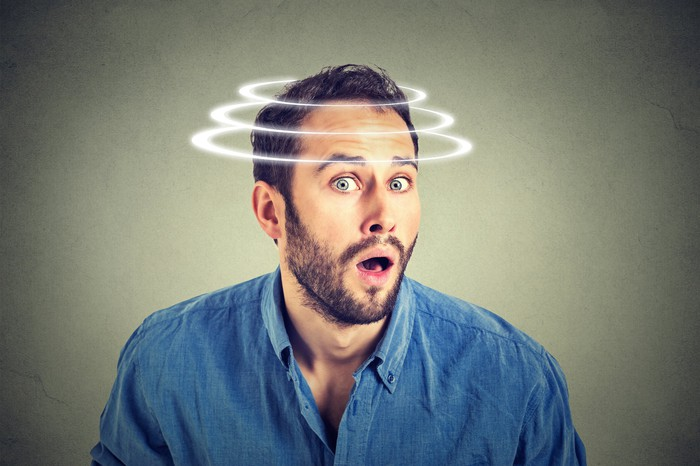 Surprised man with images of spirals over his head to give an impression that his head was spinning