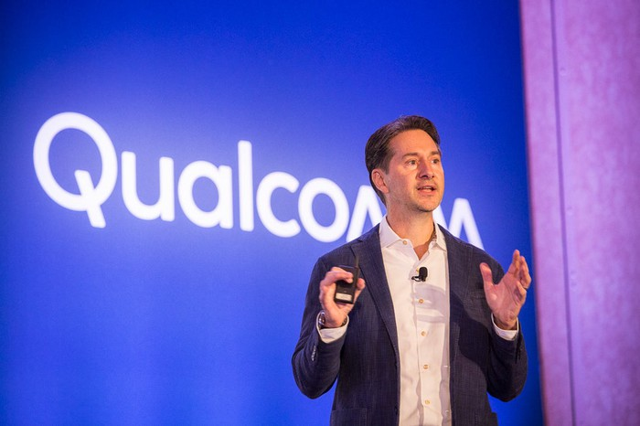 Qualcomm VP of corporate communications on stage at a Qualcomm event.
