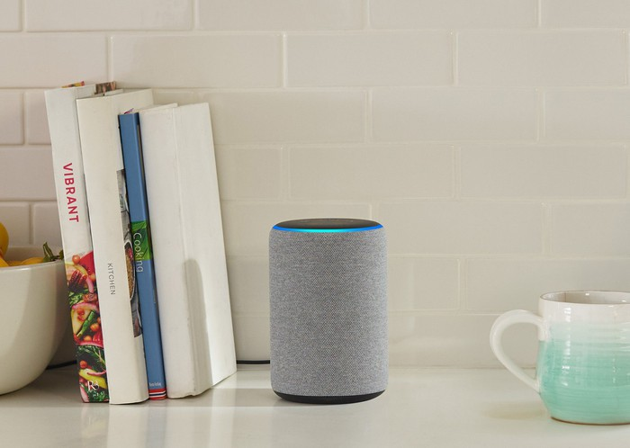 An Amazon Echo smart speaker sitting on a countertop