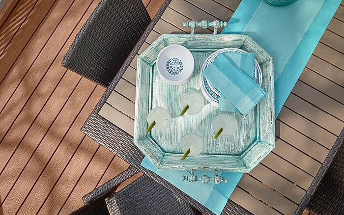 Trex Enhance series decking, shown from above a table bearing a blue wooden tray