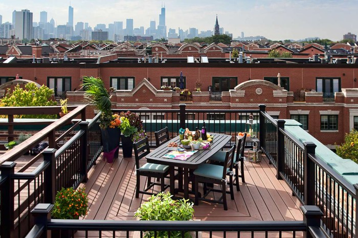 A Trex deck on a rooftop, with the Chicago skyline in the distance