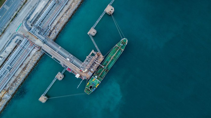 An aerial view of an LNG tanker at port.