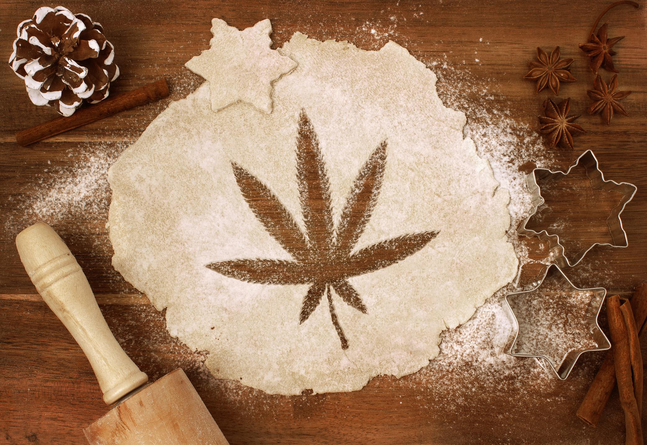 Flour on a table with a marijuana leaf