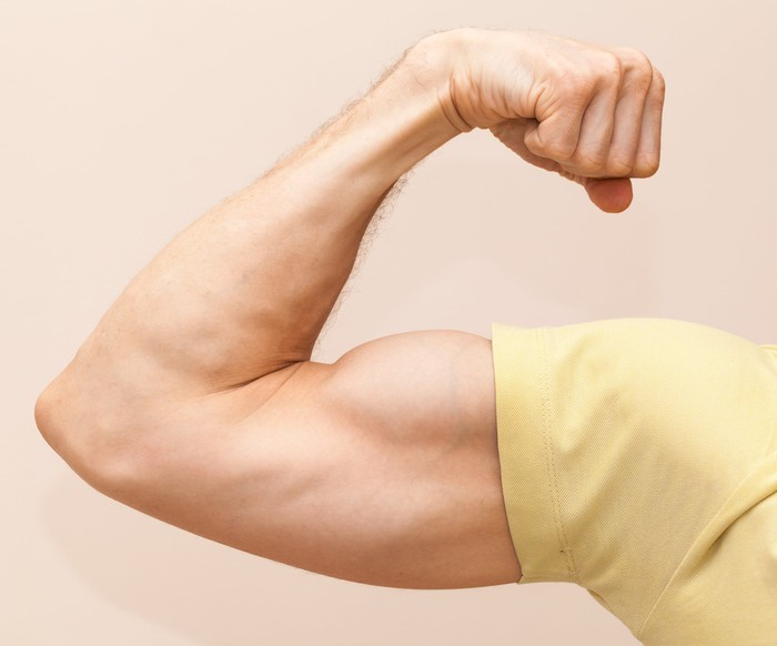 A strong arm flexing the bicep
