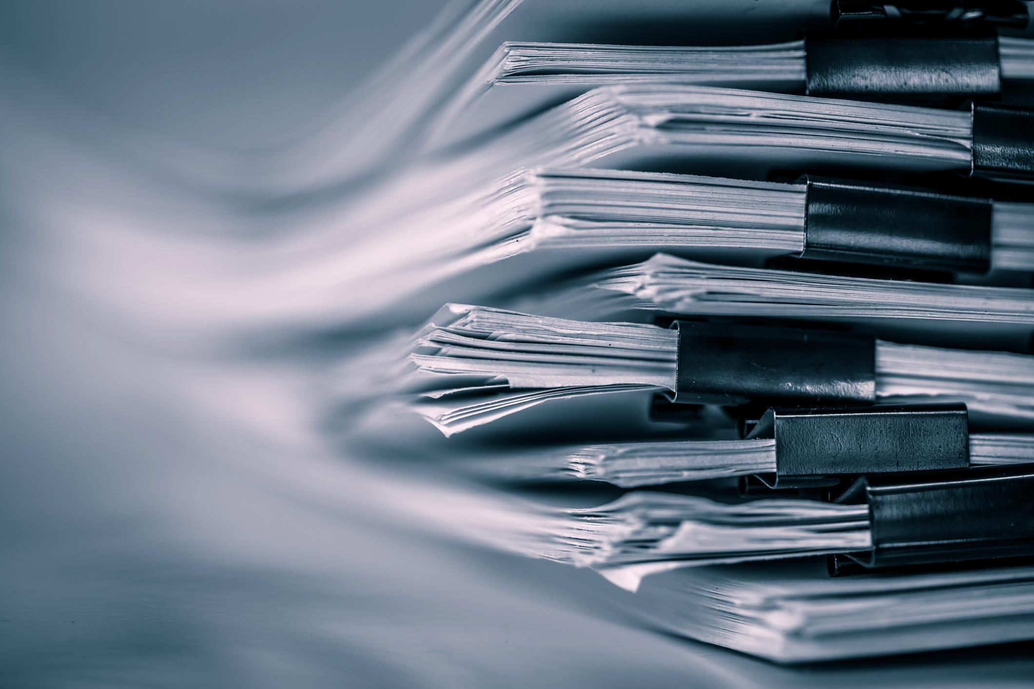 Pile of paperwork in binder clips.