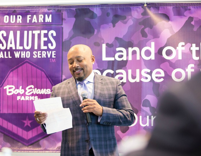 """Daymond John speaking on stage at the Bob Evans Farms """"Heroes to CEOs"""" event"""