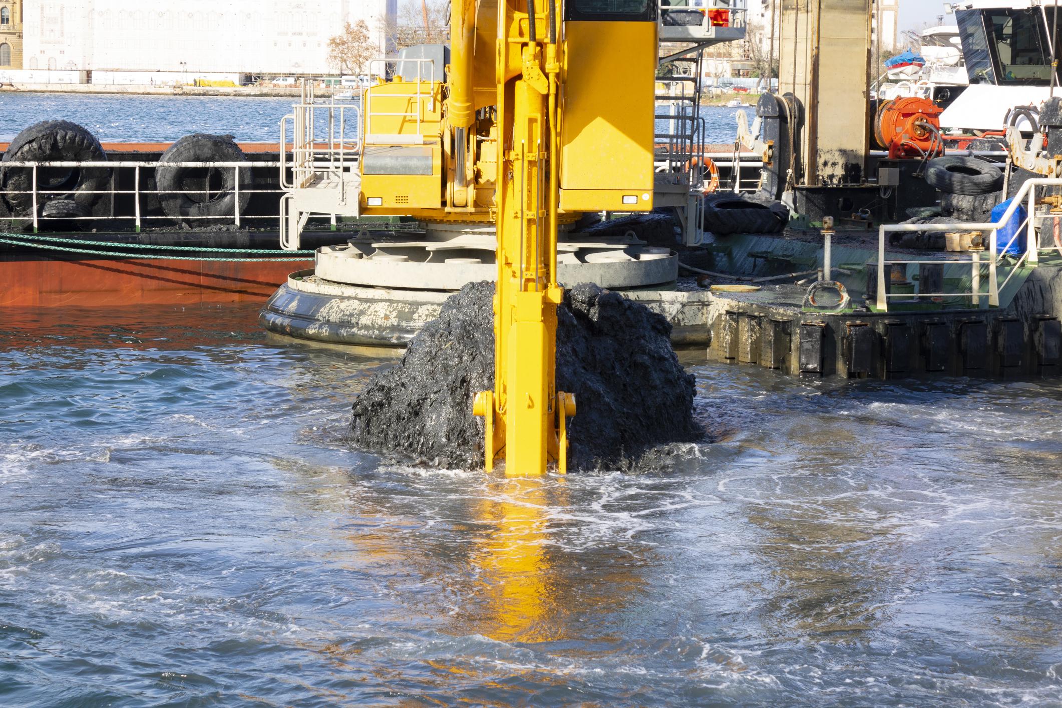 Excavator dredging a river