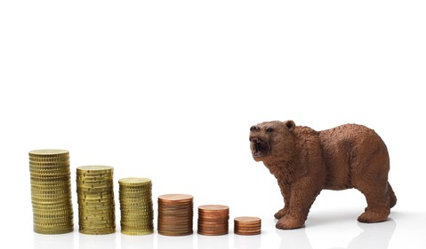 Bear and coins heading downward