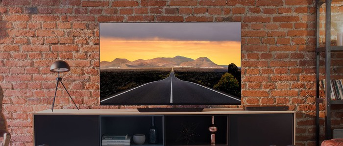 An LG OLED big screen TV displayed in a living room.