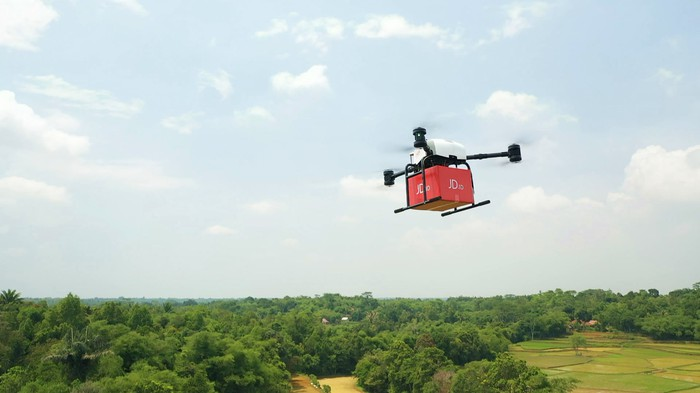 A JD delivery drone in flight.