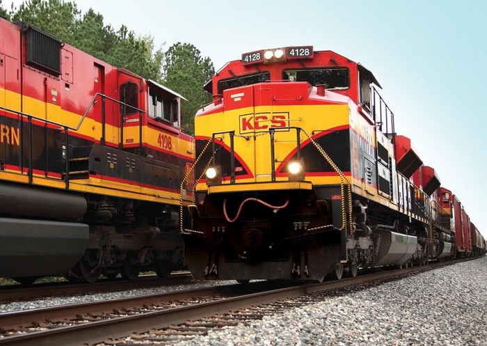 Two Kansas City Southern locomotives pass each other.