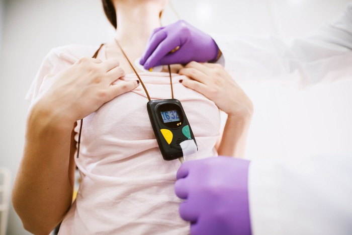 Woman wearing a Holter monitor