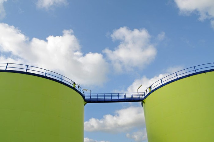 Two fuel storage tanks painted green.