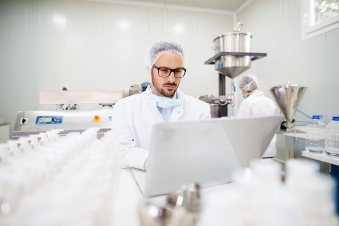 A man in a drug development lab.