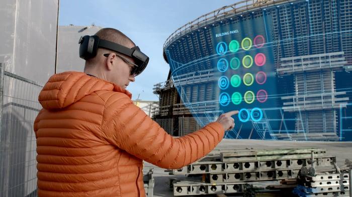 A man uses a Microsoft HoloLens.
